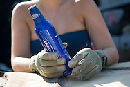 NEWS&GUIDE PHOTO / PRICE CHAMBERS.With mechanics' gloves and other necesities, Rebecca Smith is ready to work on the Redneck Racing derby cars at the King residence last week.
