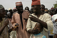 A Nigerian man pretends to be angry at vaccinators for trying to immunize his son during a skit at an opening ceremony on the first day of the National Immunization Campaign in Tudun Wada. The skits are held to stress the importance of immunizing children against polio.