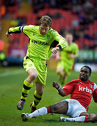 LONDON, ENGLAND - Saturday, January 30, 2010: Charlton Athletic's  Sam Sodje slides in to stop Tranmere Rovers' Ian Moore during the Football League One match at the Valley. (Photo by Gareth Davies/Propaganda)