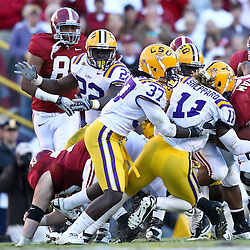 November 6, 2010; Baton Rouge, LA, USA;  Alabama Crimson Tide running back Mark Ingram (22)  is tackled by LSU Tigers linebacker Kelvin Sheppard (11) and safety Karnell Hatcher (37) during the second half at Tiger Stadium. LSU defeated Alabama 24-21.  Mandatory Credit: Derick E. Hingle
