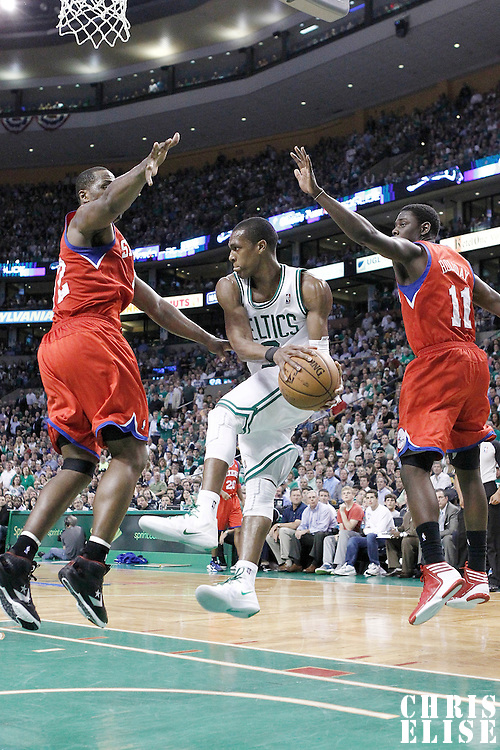 21 May 2012: Boston Celtics point guard Rajon Rondo (9) looks to pass in the traffic past Philadelphia Sixers point guard Jrue Holiday (11) and Philadelphia Sixers power forward Elton Brand (42) during the Boston Celtics 101-85 victory over the Philadelphia Sixer, in Game 5 of the Eastern Conference semifinals playoff series, at the TD Banknorth Garden, Boston, Massachusetts, USA.