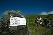 A sign marks the distances and the altitude of the starting point and the summit. Pico is the highest portuguese mountain with 2351m high