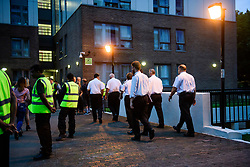 © Licensed to London News Pictures. 23/06/2017. London, UK. Members of the fire service enter the building as residents are evacuated from the Taplow block of the Chalcots Estate in Camden after it failed a fire inspection because of combustable cladding. Prime Minister Theresa May has told Parliament that up to 600 high rise tower blocks may have similar cladding to that found in Grenfell Tower, which went on fire last week, in which as many as 79 residents are thought to have perished Photo credit: Ben Cawthra/LNP