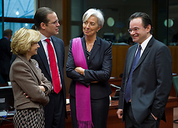 George Papaconstantinou, Greece's finance minister, right, speaks with Elena Salgado, Spain's finance minister, left, Anders Borg, Sweden's finance minister, left center, and Christine Lagarde, France's finance minister, during the meeting of European Union finance ministers, at the EU headquarters in Brussels, Belgium, on Tuesday, March 16, 2010. (Photo © Jock Fistick)