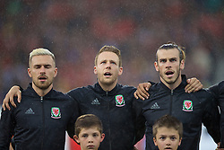 LILLE, FRANCE - Friday, July 1, 2016: Wales' Aaron Ramsey, Chris Gunter and Gareth Bale sing the national anthem before the UEFA Euro 2016 Championship Quarter-Final match against Belgium at the Stade Pierre Mauroy. (Pic by David Rawcliffe/Propaganda)