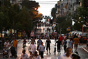 Israelis mingle and stroll in a central Tel-Aviv street void of all cars and traffic on the high Jewish holiday of Yom kippur, the day of Atonement. Traffic is prohibited in Israel as the country come to a standstill for 25-hours during the holiday as relgious Jews flock to synagogues<br />