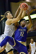 Vanderbilt Commodores forward Yanni Wetzell (1) goes for the rebound against Alcorn State Braves forward DeShaw Andrews (12) during the first half of a NCAA college basketball game in Nashville, Tenn., Friday, Nov 16, 2018. (Jim Brown/Image of Sport)