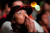 SAN FRANCISCO, CA - NOV 1:  Angela Short of Vallejo, California watches the Giants defeat the Texas Rangers to win the World Series in 5 games at the Civic Center Plaza on November 1, 2010 in San Francisco, California.  The Giants won their first World Series in 56 years since moving to San Francisco from New York.  Photograph by David Paul Morris