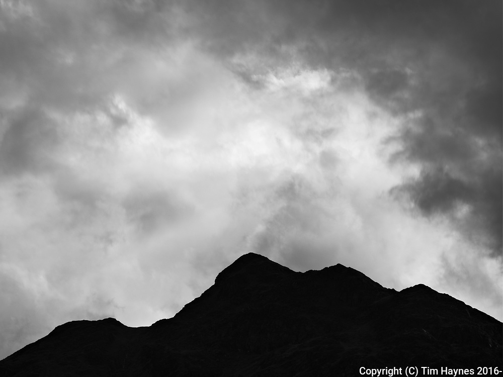 Contrasty drama: turbulent cloudy sky over the tops of Am Bioran, Strathearn, just outside St Filan's.
