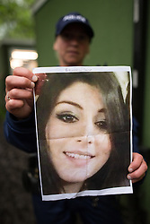 © Licensed to London News Pictures . 12/06/2016 . Manchester , UK . A GMP officer holds up a photograph of 26 year old Rebecca Dacre from Ulverston who has gone missing after attending the Parklife festival yesterday (Saturday 11th June 2016) . Parklife music festival at Heaton Park in Manchester . Photo credit : Joel Goodman/LNP