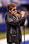 American country music singer, songwriter, and actor Billy Ray Cyrus sings the National Anthem prior to the Indianapolis Colts NFL week 8 football game against the Houston Texans on Monday, November 1, 2010 in Indianapolis, Indiana. The Colts won the game 30-17. ©Paul Anthony Spinelli
