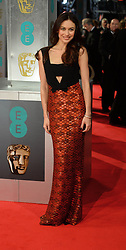 Olga Kurylenko arrives for the EE BRITISH ACADEMY FILM AWARDS 2014 (BAFTA) at the The Royal Opera House in Covent Garden . London, United Kingdom. Sunday, 16th February 2014. Picture by Andrew Parsons / i-Images