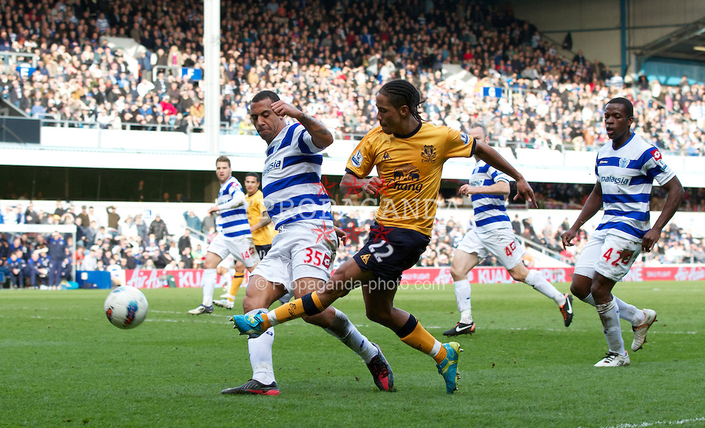 LONDON, ENGLAND - Saturday, March 3, 2012: Everton's Steven Pienaar in action against Queens Park Rangers' Anton Ferdinand during the Premiership match at Loftus Road. (Pic by Vegard Grott/Propaganda)