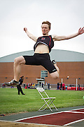 Gavin Warnock '14 leaps through the air during the Men's long jump competition at the Dick Young Classic at Grinnell College. BEN BREWER/Grinnell College