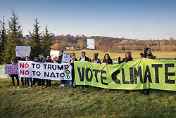 © Licensed to London News Pictures. 04/12/2019. Watford, UK. A small group of protesters stand in an area designated for demonstrators near the gates to The Grove Hotel where NATO leaders are meeting. World leaders are attending a series of events over the two day NATO summit which will mark the 70th anniversary of the alliance of nations. Photo credit: Peter Macdiarmid/LNP