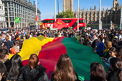 London, October 11th 2014. Thousands of protesters from the UK's Kurdish community demonstrate in London against the delay in assisting the people of the Syrian city of Kobane in their fight against ISIS. They also accuse Turkey, with whom the Kurds have had a long-running insurgency of siding with the Islamic State by doing nothing to help Kurds in Kobane. PICTURED: A giant flag billows as women and children chant slogans.