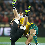 Digby Ioane tackles All Black Adam Thomson during the New Zealand V Australia Tri-Nations, Bledisloe Cup match at Eden Park, Auckland. New Zealand. 6th August 2011. Photo Tim Clayton