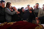 rena Shaulov (L), mother of David Shaulov, reacts as she holds the stomach of her 9-month-pregnant daughter-in-law Radmila during David's funeral in the town of Holon, near Tel Aviv, Tuesday April 18, 2006. David Shaulov was killed by suicide bomb attack outside a packed Tel Aviv fast food restaurant