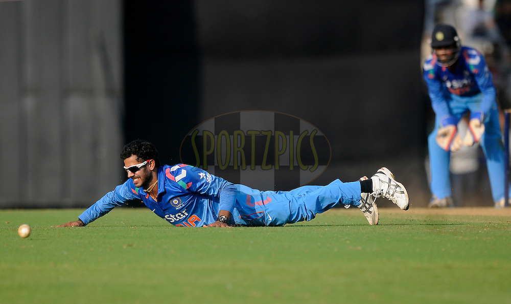 Manoj Tiwary captain of India A tries to stop a ball of his own bowling during the practice match between India A and Sri Lanka held at the CCI Stadium, Mumbai,  India on the 30th October 2014<br /> <br /> Photo by:  Pal Pillai/ Sportzpics/ BCCI