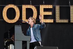 © Licensed to London News Pictures. 13/06/2014. Isle of Wight, UK.   Tom Odell performing live at Isle of Wight Festival  2014.   Tom Odell is a british singer-songwriter.  He released is debut LP in 2012, and won the Brit awards Critics Choice Award in 2013, and released his debut studio album in June 2013.  The Isle of Wight festival is an annual music festival that takes place on the Isle of Wight. Photo credit : Richard Isaac/LNP