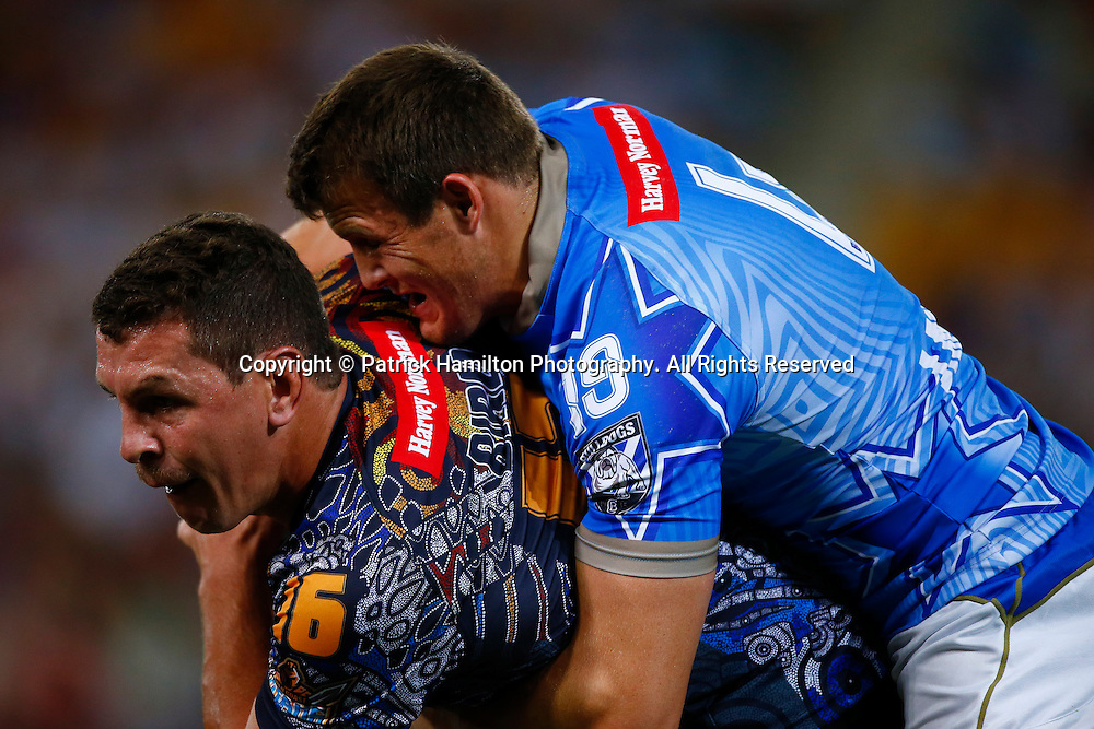 Greg Bird is tackled by Kieran Foran during the NRL All Stars game at Suncorp Stadium, Brisbane on February 09, 2013.