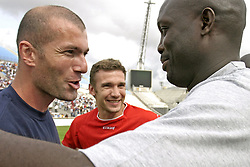File photo : Liberia's Former FIFA World Player of the Year George Weah and France's Zinedine Zidane during Weah farewell match at the Velodrome stadium in Marseille on June 11, 2005. Weah is moving from football to politics, planning to contest the presidential election due in Liberia by October.Former football star George Weah has been elected as Liberia's president. Mr Weah is well ahead of opponent Joseph Boakai with more than 60% of the vote. Photo by Gerald Holubowicz/ABACA.