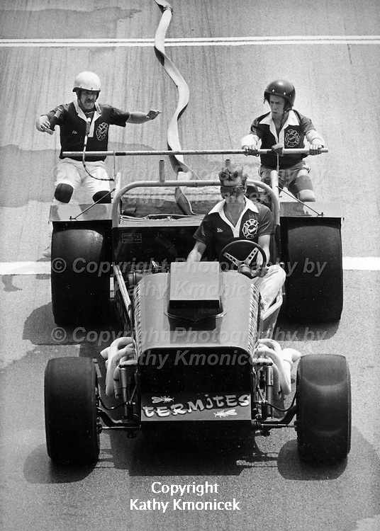 The New Hyde Park Fire Department Termites Racing Team in action in August of 1982.