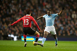 MANCHESTER, ENGLAND - Wednesday, November 10, 2010: Manchester City's Kolo Toure and Manchester United's Ji-Sung Park during the Premiership match at the City of Manchester Stadium. (Pic by: Chris Brunskill/Propaganda)