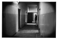 Man, whose family member is a psychiatric patient stands in hallway of Kabul's only gov?t run mental hospital, Psychiatric and Drug Dependency Hospital, Kabul, Afghanistan.  Family members often come from hundreds of kilometers away to be with patients while at the hospital.