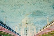 Reflection of the Taj Mahal at the main lake of its gardens