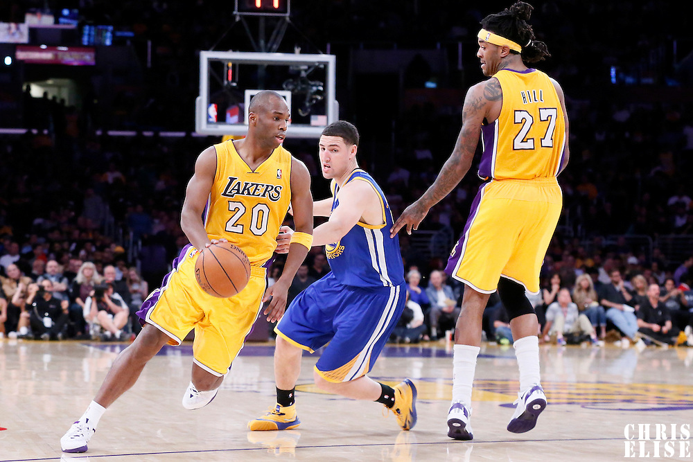 11 April 2014: Los Angeles Lakers guard Jodie Meeks (20) drives past Golden State Warriors guard Klay Thompson (11) during the Golden State Warriors 112-95 victory over the Los Angeles Lakers at the Staples Center, Los Angeles, California, USA.