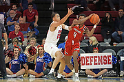 SMU Mustangs forward Ethan Chargois (25) defends against Hartford Hawks guard Moses Flowers (4) during an NCAA college basketball game, Wednesday, Nov. 27, 2019, in Dallas.SMU defeated Hartford 90-58. (Wayne Gooden/Image of Sport)