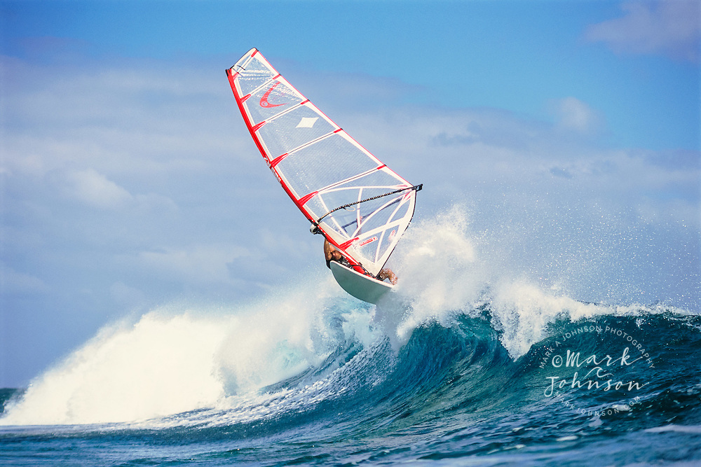 Kauai, Hawaii, USA --- Windsurfing on Breaking Wave