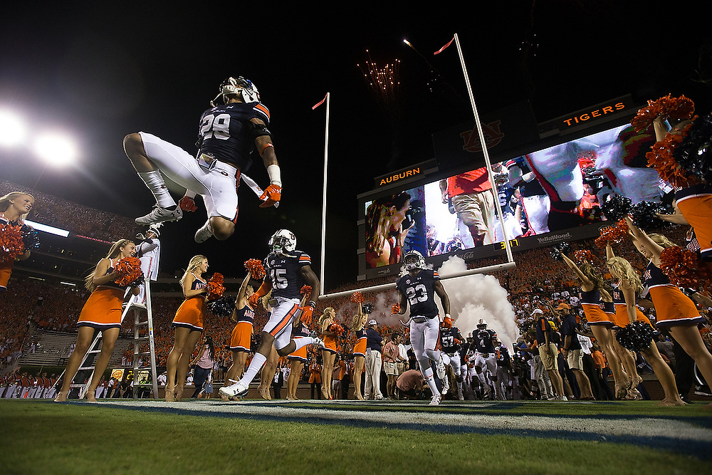 Auburn's Tray Matthews (28) jumps while running onto the field for the season-opening game against Clemson. <br /> No. 2 Clemson Tigers vs. Auburn Tigers at Jordan-Hare Stadium in Auburn, Ala. on Saturday, Sept. 3, 2016.<br /> Zach Bland/For the Opelika-Auburn News