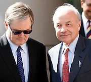 Former Enron chairman Kenneth Lay (R) leaves the Bob Casey U.S. Courthouse with his George Secrest (L) following proceedings in his fraud and conspiracy trial, May 16, 2006, in Houston. The defense presented it's closing arguments in the trial that has spanned 16 weeks. (Photo by Dave Einsel)