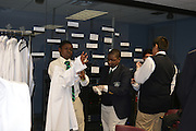 Mickey Leland ninth-grade biology students don lab coats before entering the Health Museum's DeBakey Cell Lab.