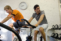 Discovery Channel Pro Cycling Team members Ryder Hesjedal (left) and George Hincapie work out at Peak Performance Adventure Gym. Long successful in the European classics, in addition to being Lance Armstrong's right hand man on the team, Hincapie took his first Tour de France stage win in 2005.<br />