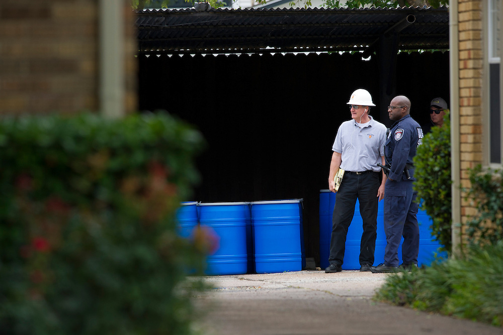 A Dallas police officer speaks with the haz-mat crew outside the apartment where a second Ebola patient has been reported in Dallas, Texas on October 13, 2014. (Cooper Neill for The New York Times)