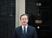 © London News Pictures. 30/03/2015 . David Cameron makes a statement on Downing Street. British prime minister DAVID CAMERON and deputy prime minister NICK CLEGG leave Number 10 Downing Street in London to travel to Buckingham Palace to inform the Queen of the dissolution of Parliament ahead of the general election. Photo credit : Stephen Simpson/LNP