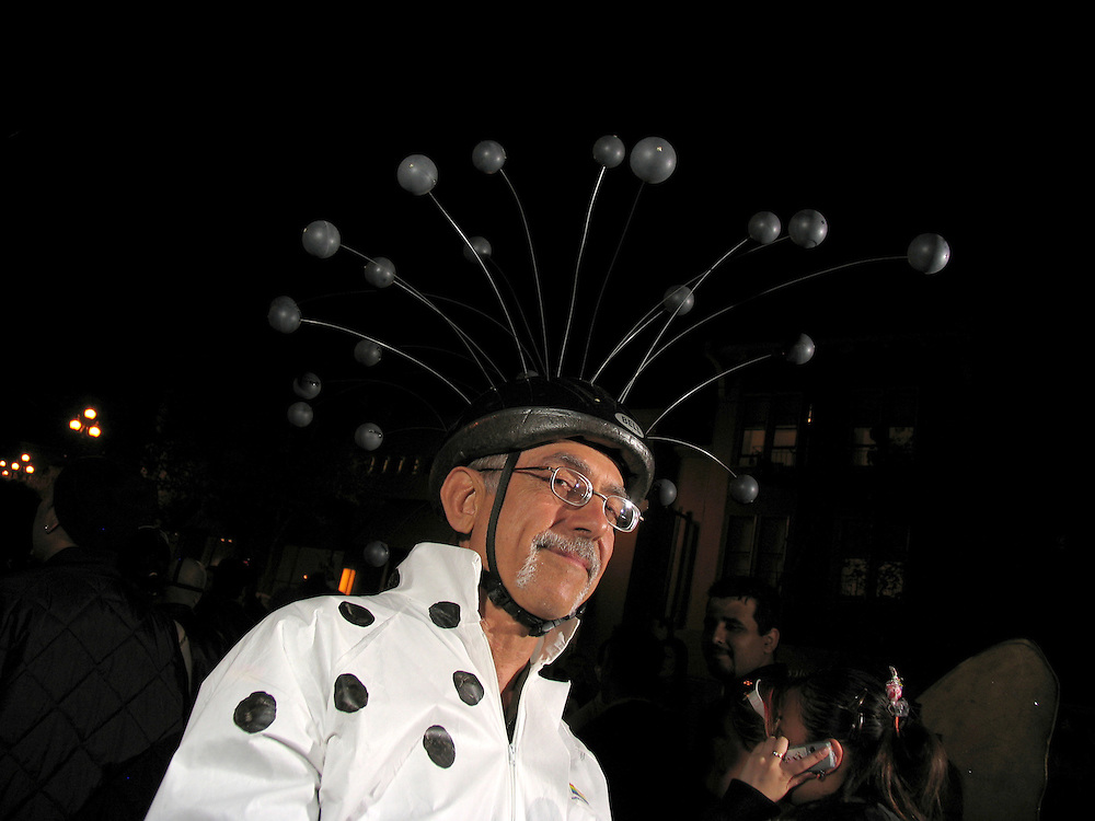 Halloween in The Castro, San Francisco, CA. I'm not really sure what this costume was all about, but it looked like he had lots of small planets orbiting his head.