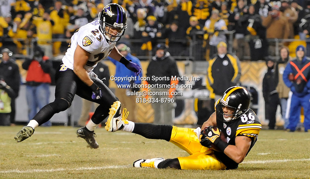 Jan. 15, 2011 - Pittsburgh, Pennsylvania, U.S. - .January 15, 2011..Steelers HInes Ward pulls in a pass for a touchdown in front of Ravens Chris Carr in the third quarter at Heinz Field Saturday