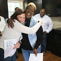 Michelle Shepherd, Northeast Mississippi Habitat for Humanity Executice Director, receives a hug from Daphne Waldrop, new habitat homeowner, after the blessing of the home for Waldrop Monday afternoon in Verona.