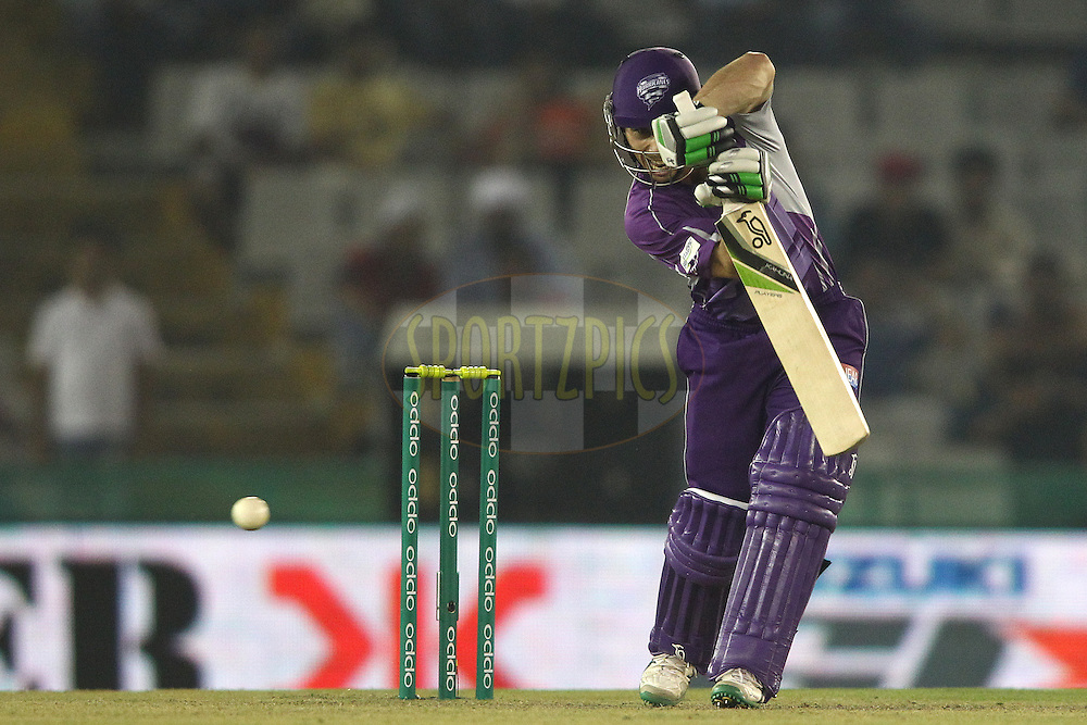 Jon Wells of the Hobart Hurricanes drives a delivery through the covers during match 2 of the Oppo Champions League Twenty20 between the Kings XI Punjab and the Hobart Hurricanes held at the Punjab Cricket Association Stadium, Mohali, India on the 18th September 2014<br /> <br /> Photo by:  Shaun Roy / Sportzpics/ CLT20<br /> <br /> <br /> Image use is subject to the terms and conditions as laid out by the BCCI/ CLT20.  The terms and conditions can be downloaded here:<br /> <br /> http://sportzpics.photoshelter.com/gallery/CLT20-Image-Terms-and-Conditions-2014/G0000IfNJn535VPU/C0000QhhKadWcjYs