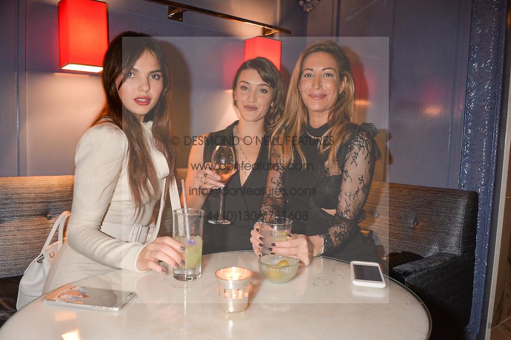 LONDON, ENGLAND 8 DECEMBER 2016: Doina Ciobanu, Eleanor Gecks, Laura Pradelska at the Omega Constellation Globemaster Dinner at Marcus, The Berkeley Hotel, Wilton Place, London England. 8 December 2016.