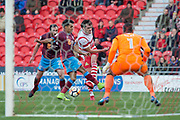 Doncaster Rovers Forward John Marquis (9) trys to cross the ball into the boxl during the The FA Cup match between Doncaster Rovers and Scunthorpe United at the Keepmoat Stadium, Doncaster, England on 3 December 2017. Photo by Craig Zadoroznyj.