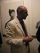 Darius Meibodi, Private and Confidential, work by Predrag Pajdic , Catto Contemporary, 6 March 2003.<br /> Private & Confidential© Copyright Photograph by Dafydd Jones 66 Stockwell Park Rd. London SW9 0DA Tel 020 7733 0108 www.dafjones.com