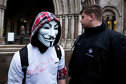 © Licensed to London News Pictures. 18/01/2012. LONDON, UK. A masked protester leaves the Royal Courts of Justice during the Occupy London v the Corporation of London case in London today (18/01/12). The demonstrators, at this time camped outside St Paul's Cathedral, lost their case against the City of London Corporation.  Photo credit: Matt Cetti-Roberts/LNP