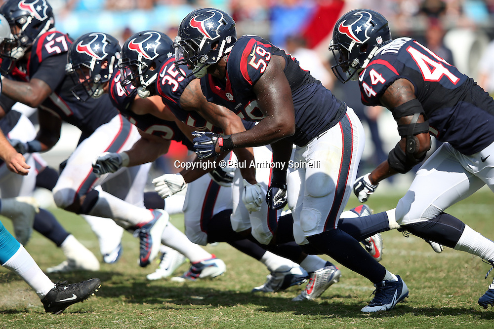 The Houston Texans defensive line rushes during the 2015 NFL week 2 regular season football game against the Carolina Panthers on Sunday, Sept. 20, 2015 in Charlotte, N.C. The Panthers won the game 24-17. (©Paul Anthony Spinelli)