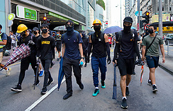 Tuen Mun, Hong Kong. 22 September 2019. Pro democracy demonstration and march through Tuen Mun in Hong Kong. Marchers protesting against harassment by sections of the pro Beijing community. Largely peaceful march had several violent incidents with police using teargas. Several arrests were made. Pictured; Black clad leaders.  Iain Masterton Live News.