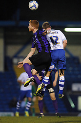 Bristol Rovers' Matt Harrold challenges Bury's Chris Sedgwick to the header - Photo mandatory by-line: Dougie Allward/JMP - Mobile: 07966 386802 01/04/2014 - SPORT - FOOTBALL - Bury - Gigg Lane - Bury v Bristol Rovers - Sky Bet League Two